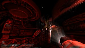 Screenshot of a corridor with a body in Doom 3 running in widescreen.